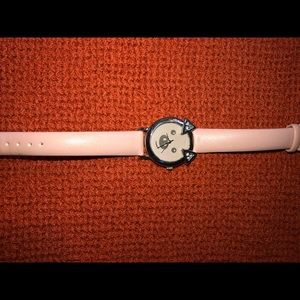 Used women's Pig pink character watch.